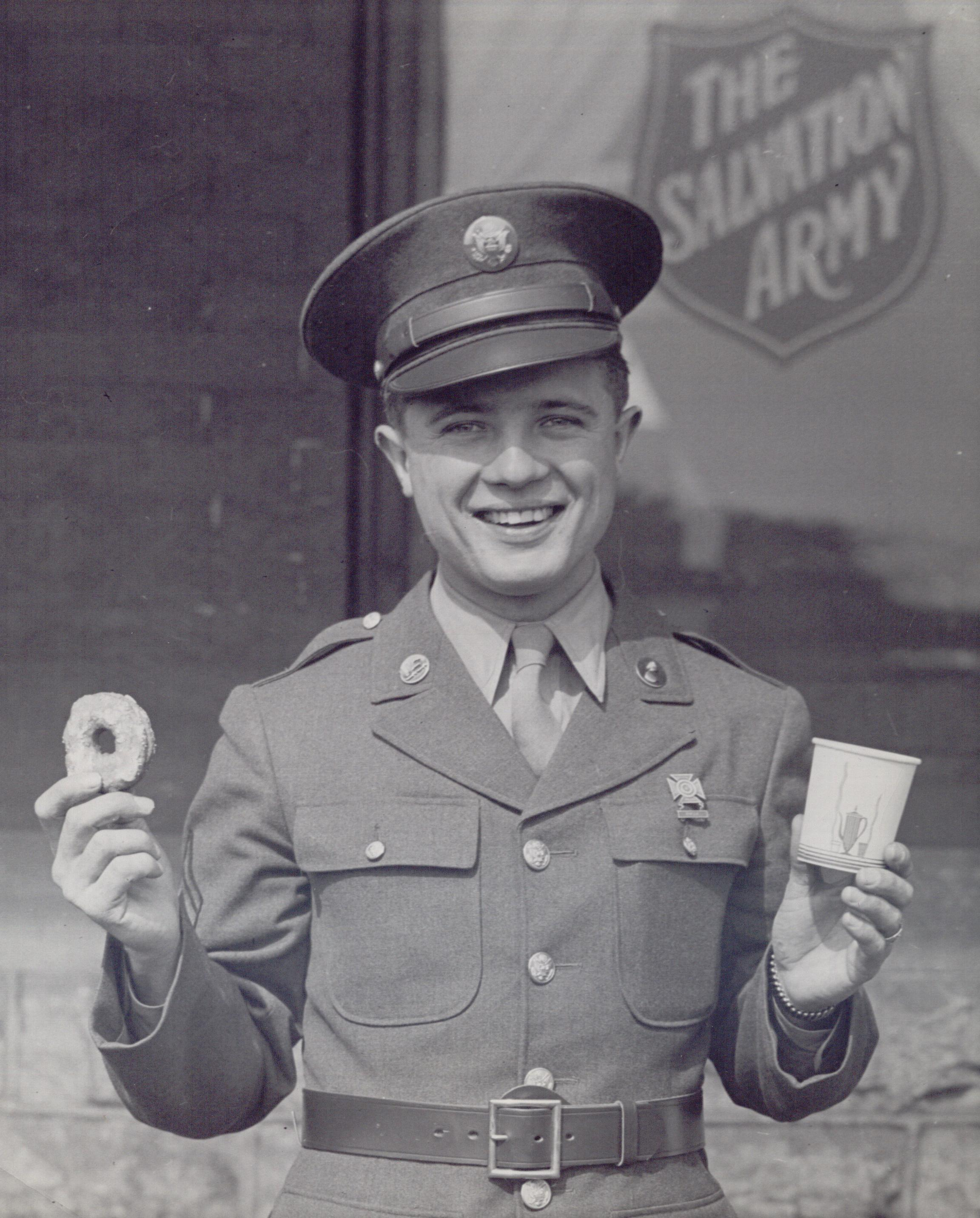 Dennison, OH Canteen - Serviceman Holding Donut and Coffee