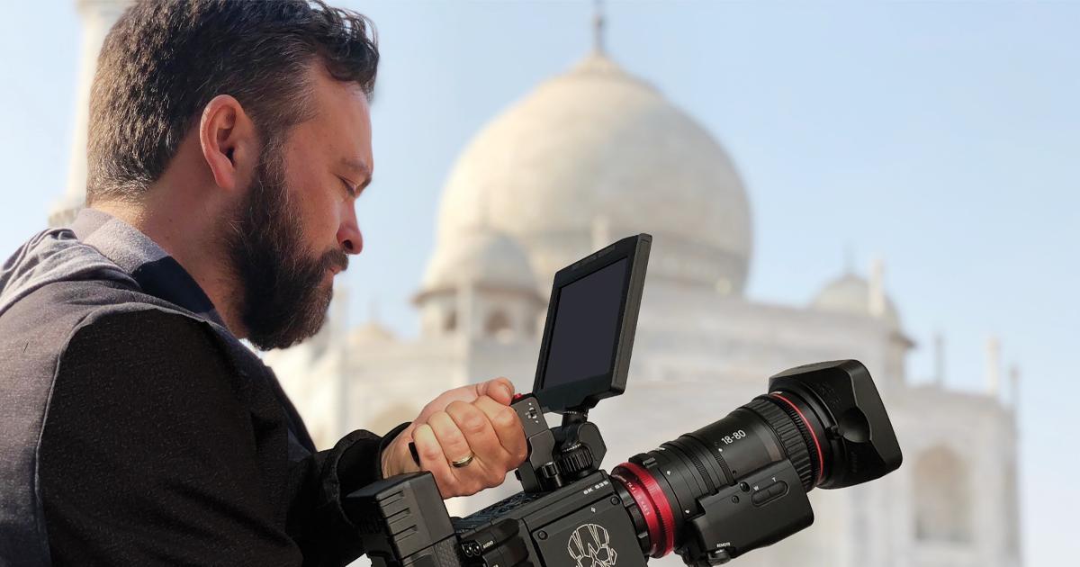 Daniel Kennedy holding a camera.